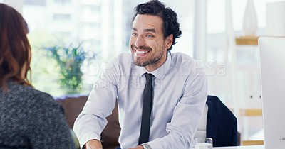 Buy stock photo Shot of a young businessman having a meeting with a woman in an office