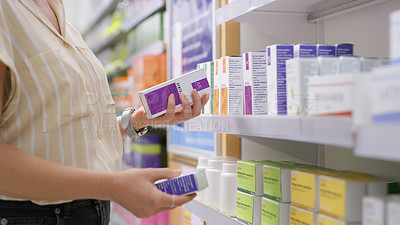 Buy stock photo Shot of an unrecognizable woman browsing the shelves of a pharmacy