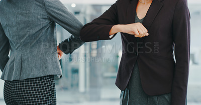Buy stock photo Shot of two unrecognisable businesswoman bumping elbows in a modern office