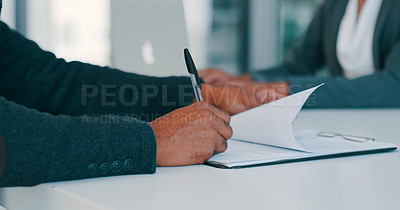 Buy stock photo Cropped shot of a businessman filling out paperwork during a meeting in a modern office