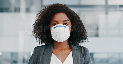 Buy stock photo Shot of a young businesswoman wearing a protective mask in a modern office