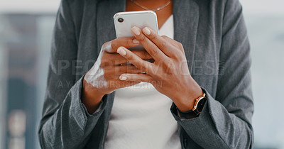 Buy stock photo Cropped shot of a businesswoman using a smartphone in a modern office