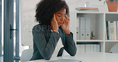 Buy stock photo Shot of a young businesswoman looking stressed at her desk in a modern office