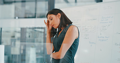 Buy stock photo Shot of a young businesswoman looking stressed in a modern office