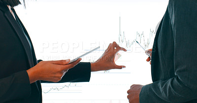 Buy stock photo Cropped shot of a businessman and businesswoman using an interactive whiteboard to analyse data in a modern office