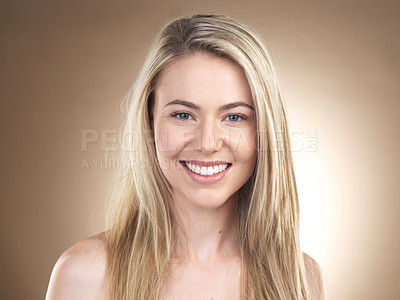 Buy stock photo Cropped shot of a beautiful young woman posing against a brown background