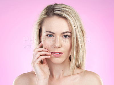 Buy stock photo Cropped shot of a beautiful young woman posing against a pink background