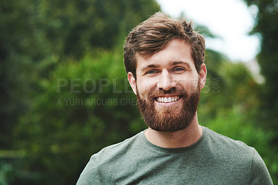 Buy stock photo Portrait of a confident young man standing in his backyard
