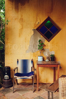 Buy stock photo Shot of a chair, table and plants on the patio at home