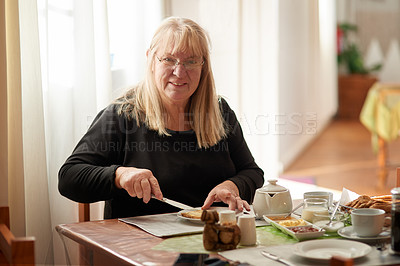 Buy stock photo Portrait of a young woman having breakfast at home