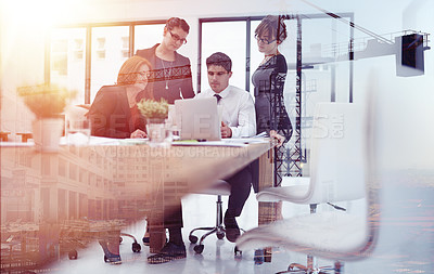 Buy stock photo Shot of a team of businesspeople in a meeting superimposed over a build site