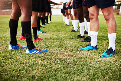 Buy stock photo Cropped shot of a group of rugby players shaking hands on the field