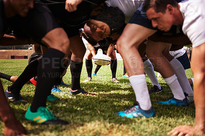 Buy stock photo Cropped shot of a group of rugby players in a scrum on the field