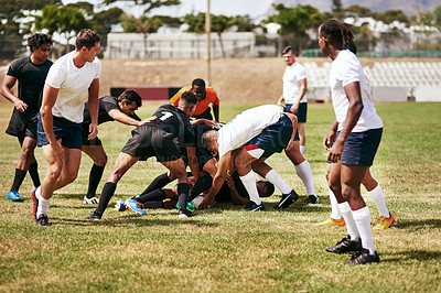 Buy stock photo Shot of a group of young men playing a game of rugby