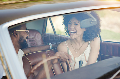 Buy stock photo Shot of a young couple going a road trip together