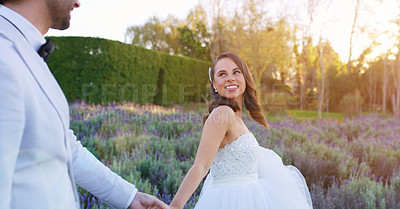 Buy stock photo Cropped shot of a bride pulling her husband by the hand