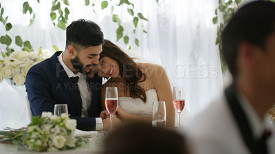 Buy stock photo Shot of a newly married young couple enjoying their wedding reception
