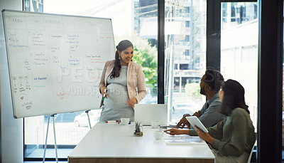 Buy stock photo Cropped shot of a group of businesspeople having a meeting in the boardroom