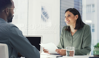 Buy stock photo Cropped shot of two young businesspeople sitting in a meeting