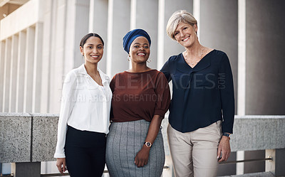 Buy stock photo Portrait of a group of businesswomen standing together against a city background