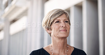 Buy stock photo Shot of a mature businesswoman walking through the city