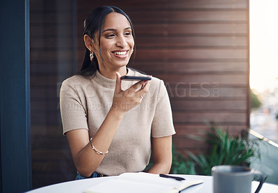 Buy stock photo Cropped shot of an attractive young businesswoman making a phonecall while working in her office
