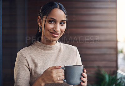 Buy stock photo Cropped portrait of an attractive young businesswoman drinking her coffee while working in the office