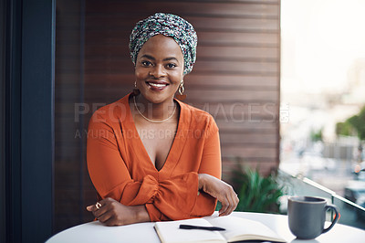 Buy stock photo Cropped portrait of an attractive businesswoman working at a desk in her office