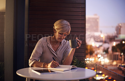 Buy stock photo Cropped shot of an attractive mature businesswoman taking notes while working late in her office