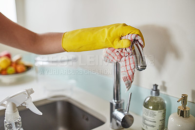 Buy stock photo Cropped shot of a woman cleaning a faucet at the kitchen sink