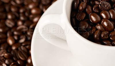 Buy stock photo Closeup shot of a cup filled with coffee beans