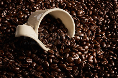 Buy stock photo Closeup shot of a cup on a pile of coffee beans