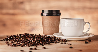 Buy stock photo Closeup shot of a paper cup and teacup surrounded by coffee beans