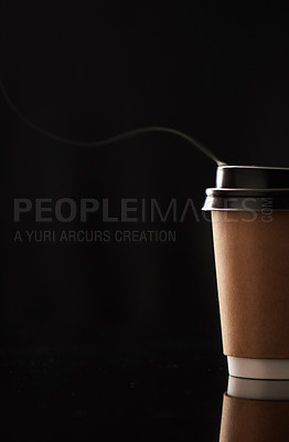 Buy stock photo Closeup shot of steam rising from a paper cup filled with a warm beverage