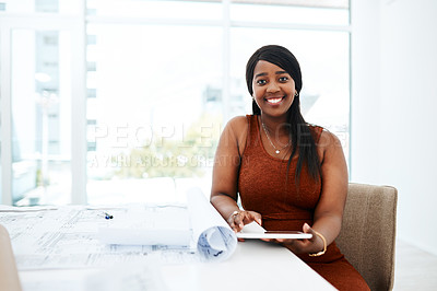 Buy stock photo Portrait of a young woman using a digital tablet while going over blueprints in a modern office