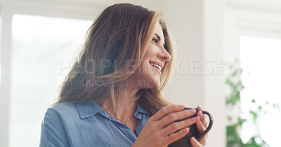 Buy stock photo Cropped shot of a beautiful woman enjoying a hot beverage at home