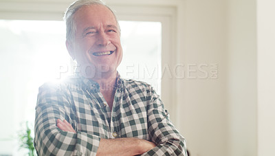 Buy stock photo Cropped shot of a happy senior man spending the day at home