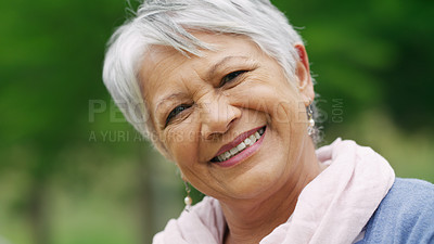 Buy stock photo Portrait of a confident senior woman enjoying a day in the park