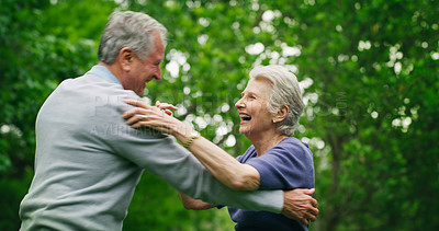 Buy stock photo Shot of a happy senior couple dancing in the park