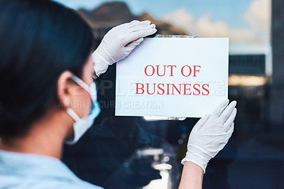 Buy stock photo Shot of a young woman wearing gloves and a mask while sticking a closed sign on her company's door