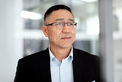Buy stock photo Shot of a mature businessman looking thoughtful in a modern office