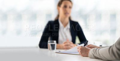 Buy stock photo Shot of two businesswomen having a meeting in a modern office