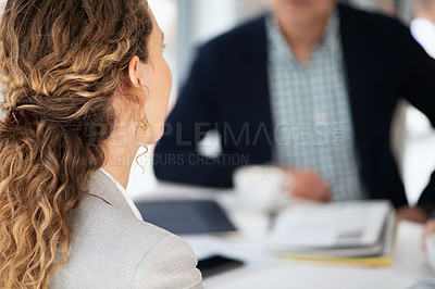 Buy stock photo Shot of a businesswoman having a meeting with her colleague in a modern office