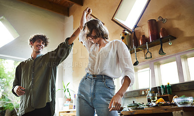 Buy stock photo Cropped shot of a loving couple dancing in the kitchen at home