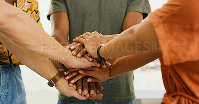 Buy stock photo Shot of a group of businesspeople joining hands in solidarity in a modern office