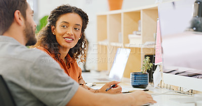 Buy stock photo Shot of a young businessman and businesswoman using a computer together in a modern office