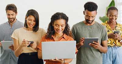 Buy stock photo Shot of a group of young businesspeople using their wireless devices in a modern office