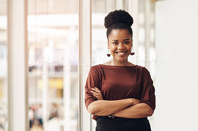 Buy stock photo Cropped portrait of an attractive young businesswoman standing with her arms crossed in the office