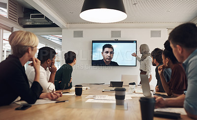 Buy stock photo Cropped shot of a group of business colleagues gathered in the boardroom for a video conference