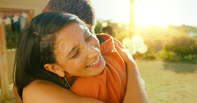Buy stock photo Shot of two young women embracing while hanging out in a garden at home